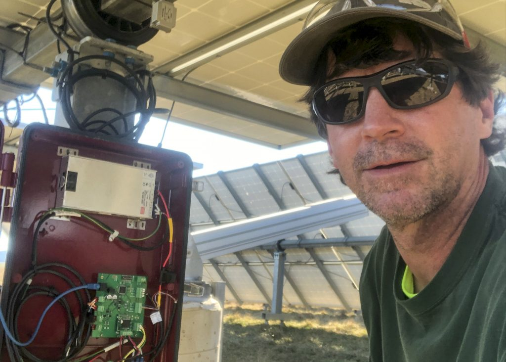 Electrician working on solar tracking system.