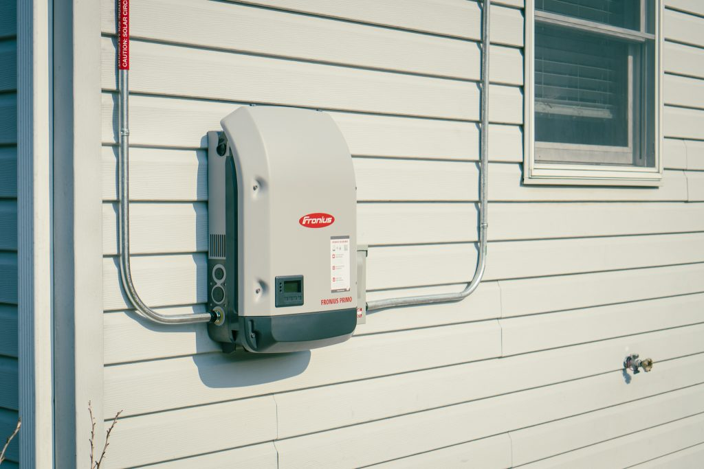 Fronius Solar Inverter on the side of a house